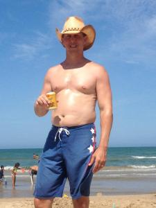 Notice how tiny the Shiner Bock can is compared with the belly backdrop. Yeesh.